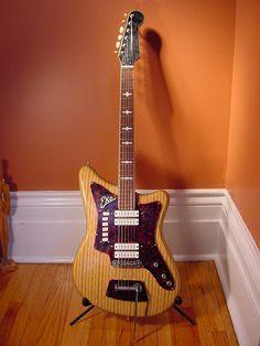 Vintage EKO 500 4V Electric Guitar (Woodgrain). myrareguitars.com