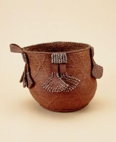 basket Materials pigment, leather, vegetal fibre, metals > iron (and alloys), bead, fat Place of collecting Namibia Culture Ovahimba