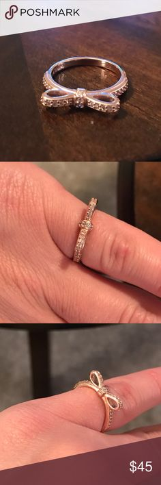 Pandora rose bow ring Like new retails for 75 size 48 which is a size 4 Pandora Jewelry Rings