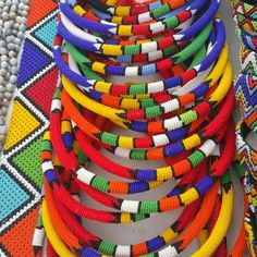 A set of 3 Handmade Zulu beaded necklace. These Brightly coloured necklaces are statement pieces that can be worn over any outfit. They are versatile and can be worn on the head as hair accessories. Customers must specify which set they prefer African Bracelets, African Necklace, African Beads, Tribal Necklace, African Jewelry, Beaded Choker, Beaded Bracelets, Zulu Women, Collar Tribal