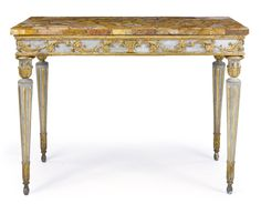 An Italian Neoclassical parcel-gilt, green-painted and carved console table late 18th century