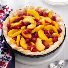 Raspberry Peach Pie Recipe -I came up with this recipe when we had a bumper crop of raspberries, and a friend gave me some of the juiciest peaches we'd ever tasted. —Jean Boelsma, Bethel, Maine