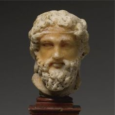 A Bi-colored Marble Head of Dionysos, Roman Imperial, circa late 1st Century A.D.