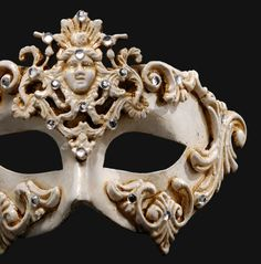 If you must wear a mask, then here's one for all Rococo Locos! White Venetian Mask [Colombina Barocco Dama ]