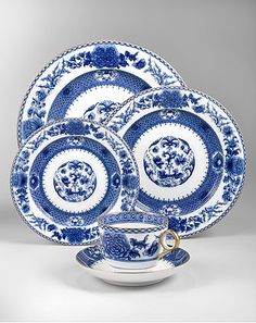 Mottahedeh Imperial Blue Dinnerware: Since the Ming Dynasty, imperial blue and white porcelains have been prized by collectors and connoisseurs around the world. Edged in 22K gold, this underglaze blue dinner service is based on a Chinese export porcelain pattern, circa 1730. The elegant design features a central flowered medallion, continuous collar and floral sprays. Dinner plate 10.5