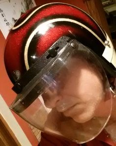Check out this Vintage Premier 1 Motorcycle Helmet. It has 5 metal snaps total, with 3 across the top and one on each side. The chin strap features Double D-Ring Retention Straps. The inside of the helmet has its original yellow sticker, which reads...CERTIFIED 2585486 SHCA APPROVED. Excellent metal flake design. The red and gold look great together and the black basecoat brings it all together. Looks like horns. Reminds me of something that Magneto from X-Men would wear. :)
