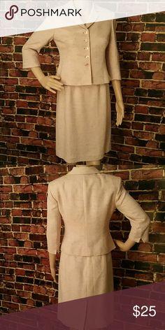 Jones New York Skirt Suit Jones New York Skirt Two Piece Skirt Suit. 72% Viscose, 16%  Cotton, 7% Acrylic, 1% Fibres, 4% Autra Fibre. Flat Measurements except for the waist. Jacket Measurements= Shoulder Measurements: 15 inches, Length: 20 inches. Skirt Measurements= Waist: 26 inches, Length: 21 inches. **Seller's Discount: 20% off 2 or more items.** Jones New York Dresses