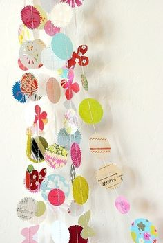 paper garlands :: lets make this for KCH's birthdays instead of using paper streamers in the doors!  she could even help by doing the sewing.  craft camp idea