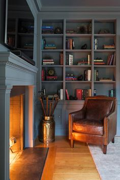 HGTV invites you to see how this blue traditional library by Chango & Co. is…