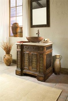 Very cool Ambella Home Sink Chest, crafted with etched brass accents, a rich Travertine stone counter, and a beautiful hammered copper vessel sink. Exotic!  EuroLuxAntiques.com