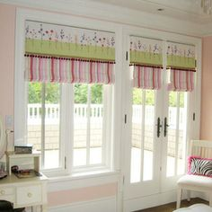 Pink & green always looks fresh & pretty. These Roman blinds with pelmets look lovely on the white painted timber window frames