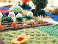 Waldorf Knitted Story Blanket Playscape on The Magic Onion. Similar to Jan Messent's knitted gardens, this is a knitted play blanket/mat with little details like the vegetables shown.