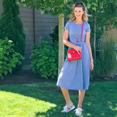 Momming and getting back into the swing of things after a trip in this blue dress funky tennie/mules cross-body bag and tassel necklace.  What are your favorite flats for summer? These were great for adding some funky color to this plain midi dress #ootd
