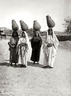 Women carrying jars of water Ein Karem, Jerusalem, Palestine 1935 .  photo by Karima Aboud