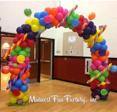 Super cute Candyland themed balloon arch for a grand entrance! Birthday party for kids décor with fun candy designs.
