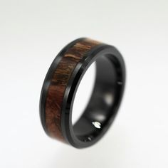 Black Tungsten Ring inlaid with Sindora Wood. via Etsy.