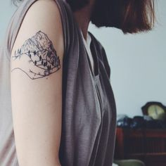 Mountains in a Palm Design - http://www.tattooideas1.org/placement/arm/mountains-in-a-palm-design/