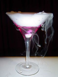 The Colour changing Martini... changes from a calm blue to fuschia as it cools from room temperature to drinkably cold, and tastes like a dirty martini.