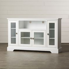 """Features:  -Color: White.  -High-grade MDF construction.  -Tempered, safety glass panes.  -Brackenville.  -Adjustable shelving.  -Four cabinets for storage.  TV Size Accommodated: -55"""".  Product Type:"""