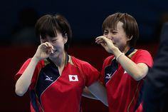 Kasumi Ishikawa (left) and Sayaka Hirano of Japan celebrate after winning the women's team table tennis semifinal match against Singapore on Aug. 5. (Feng Li/Getty Images) #