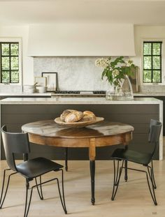 Modern Kitchen Design Quiet colors, uncluttered kitchen with stone backsplash at range and simple bouquet - If you love a quiet, humble, unfussy interior that's incredibly welcoming, Modern Traditional style might be just what your home needs. Uncluttered Kitchen, Kitchen Remodel, Kitchen Decor, Interior Design Kitchen, Kitchen Dining Room, Modern Kitchen Tables, Home Kitchens, Best Kitchen Designs, Kitchen Design