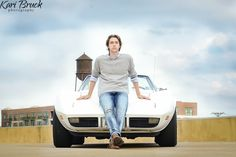 2016 High School senior guy  pictures urban downtown photo shoot session ideas. Urban inspiration with skyline with car corvette. Kari Bruck Photography Johnston Iowa