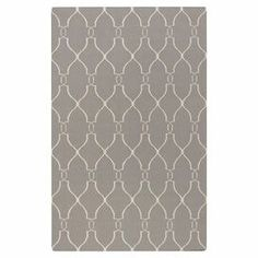 Anchor your living room or define a space in your master suite with this hand-woven wool rug, showcasing a trellis motif in taupe and cream.  Product: RugConstruction Material: WoolColor: Taupe and creamFeatures: Hand-wovenNote: Please be aware that actual colors may vary from those shown on your screen. Accent rugs may also not show the entire pattern that the corresponding area rugs have