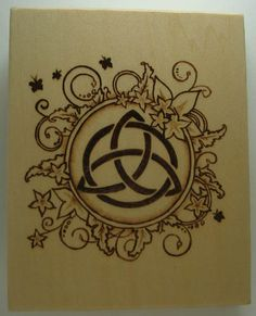 """Triquetra- The Power of Three is symbolized by a """"triquetra"""", a Celtic pattern that shows the center of three connected circles (somtimes bound together by a fourth circle in the center)."""