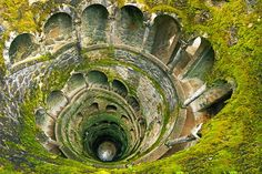 Masonic Initiation Pit, Quinta da Regaleira Estate, Sintra, Portugal This inverted tower, plunging 88 feet into the earth and with passages connecting it to other parts of the palace property, is rumored to have been the site of Masonic initiation rites. The well, constructed circa 1910, consists of stairs and landings arranged in a way that supposedly represents tarot mysticism, and at its bottom, a marble floor features the cross of the Knights Templar.