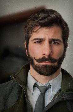 * Men with a curly mustache and beard that look awesomely handsome. ~ Don't split hairs, just get handsome.