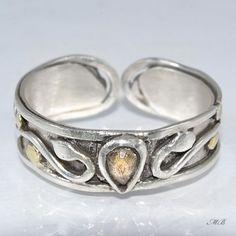 Naturalny, żółty szafir osadzony w srebrze próby 925, 999.