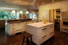 Anne Marie Barton kitchen. Love the cabinets and pulls.
