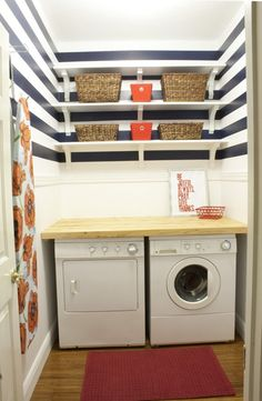 Love the stripes and baskets on the shelves! simple laundry room by A Couple of Dreamers