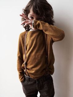 Mustard sweater with suspenders, can you say adorable.