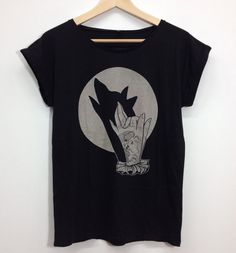 t shirt for ladies with hand shadow wolf print by Hardtimestore