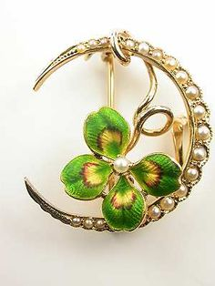 Victorian (c. 1890) half-moon-shaped brooch in gold with pearls and shamrock.