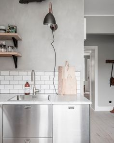 kitchen styling. stainess steel cabinets