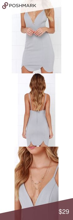 Lulu's grey body con dress! This dress has a fitted waist, a tube skirt, and a beautiful scalloped hem! This stretch knit dress is the perfect night out dress and looks great with fun accessories and your favorite pair of heels! This dress is also in perfect condition and has never been worn!✨⭐️✨ Lulu's Dresses Mini