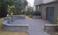 Low, short wall around patio. Room for plants or casual seating at parties. I like this idea.