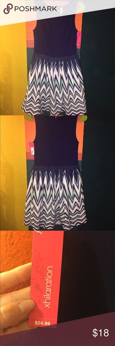 30% off 2 or more items Chevron Xhilaration dress. Fitted navy top and flowy bottom. Navy, white and light blue. Super cute for a night out or a day at work. Never worn. 18 inches from waist down. Xhilaration Dresses Midi