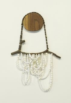 Display ideas: tree slices for necklace hanging! (necklace is by Amy Weiks)