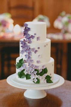 Wedding cake decorated with a sprinkling of delicate hydrangea sugar flowers by Crummb // Elegant Hydrangea-Inspired Wedding  (Instagram: theweddingscoop)