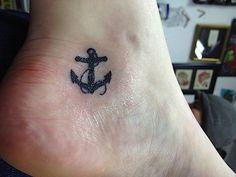 Tiny anchor tattoo: