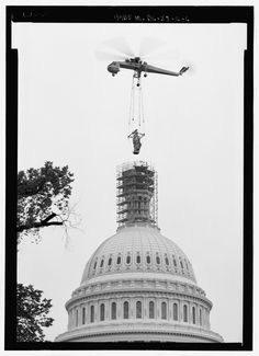 """May 9, 1993. """"View of Statue of Freedom airlifted off of the dome – U.S. Capitol, Statue of Freedom, Intersection of North, South, & East Capitol Streets & Capitol Mall, Washington, District of Columbia, DC."""" Boucher, Jack E., creator. Historic American Buildings Survey/Historic American Engineering Record/Historic American Landscapes Survey. Library of Congress."""