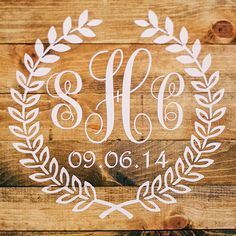 Monogram wood sign with wedding date.