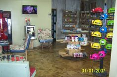 Cave City Welcome Center. Crafted in Kentucky gift shop and visitor information center.  Notice suitcase chairs, wooden spool displays, barn roofing metal walls and pallet brochure racks.