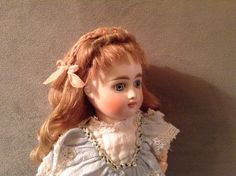 Hand-wefted mohair doll wig with ribbon work.