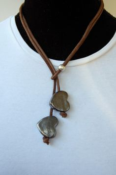 (ceramic heart necklace) Teens could make polymer clay beads then string them on cord to make a necklace like this.