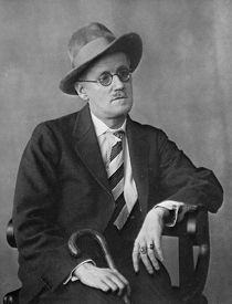 """Berenice Abbott -- One of most moving of her portraits is of James Joyce. The grey, strangely lifeless, enveloping light finds its way everywhere, describing without emphasis or favor the writer's stickpin, his hands, his right ear, his fine beaver hat, the deep tiredness of his elegant slouch. He seems the survivor of too difficult a battle, shell-shocked by the terrible labor of putting so many words in the precisely proper order.  -- from """"Looking at Photographs"""" by John Szarkowski"""