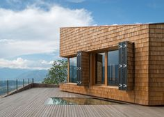 Shingle-clad cultural centre by Modostudio offers mountain views